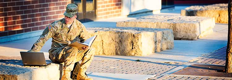 Active Duty Military Student working on a Laptop